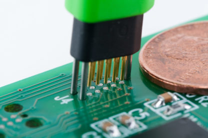TC2050 no-legs tiny footprint plug-of-nails being inserted into PCB
