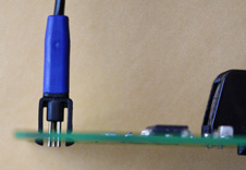 TC2030 legged miniature programming connector inserted into test PCB